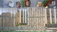 Maket proyek pembangunan rumah susun dengan konsep transit oriented development (TOD) di Stasiun Pondok Cina, Depok, Jawa Barat, Senin (2/10). (Liputan6.com/Immanuel Antonius)