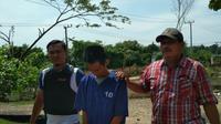 Pelaku penyiraman air raksa diamankan Polsek Gandus Palembang (Liputan6.com / Nefri Inge)