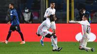 Momen selebrasi pemain Real Madrid, Ferland Mendy usai cetak gol ke gawang Atalanta, Kamis (25/02/2021) dini hari WIB. (Tiziana FABI / AFP)