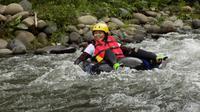 Longalo River Tubing di Desa Longalo, Kabupaten Bone Bolango, Gorontalo, adalah wisata olahraga air yang menguji adrenalin. (Arfandi Ibrahim/Liputan6.com)