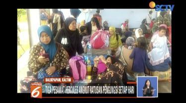 Ratusan korban gempa dan tsunami Donggala-Palu mengungsi ke Balikpapan menggunakan pesawat hercules milik TNI AU.