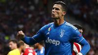 Striker Juventus, Cristiano Ronaldo, saat melawan Atletico Madrid pada laga Liga Champions di Stadion Wanda Metropolitano, Rabu (18/9/2019). Kedua tim bermain imbang 2-2. (AP/Cristiano Ronaldo)