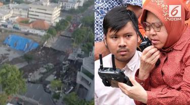 Dengan berkursi roda, Wali Kota Surabaya Tri Rismaharini kembali memantau pengerjaan perbaikan Jalan Raya Gubeng yang ambles gunakan drone.