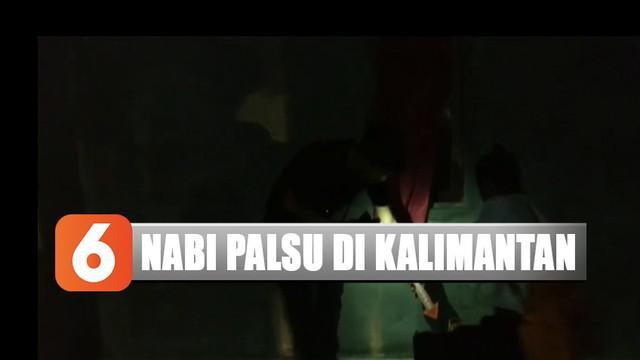Sejumlah barang bukti antara lain kitab, laptop, dan dokumen ajaran Nasruddin diamankan polisi.