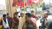 Pernikahan Muzdalifah dengan Fadel Islami di kawasan Tangerang, Banten, Sabtu (26/4/2019) pagi. (Sapto Purnomo)