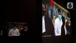 Layar menampilkan sidang putusan dari terdakwa mantan Menteri Pemuda dan Olahraga Imam Nahrawi dalam sidang secara online di gedung KPK, Jakarta, Senin (29/6/2020). Imam Nahrawi dijatuhi vonis 7 tahun penjara dan denda Rp400 juta subsider 3 bulan kurungan. (merdeka.com/Dwi Narwoko)
