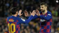 3. Gerard Pique (483 laga) - Pique menjadi rekan Lionel Messi di Barcelona sejak tahun 2008. Selama 12 tahun berseragam Barcelona, Pique tercatat 483 kali bermain bersama Messi. (AFP/Lluis Gene)