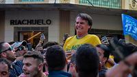Kandidat presiden Brasil, Jail Bolsonaro, mengalami serangan penikaman saat tengah berkampanye (AFP/Raysa Leite)