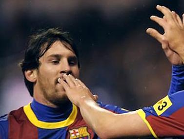 Lionel Messi dan David Villa (© AFP 2011)