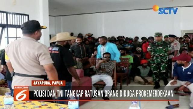 Polri-TNI bubarkan diskusi diduga makar di acara HUT Komite Nasional Papua Barat di Jayapura.
