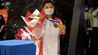 Greysia Polii tiba di Tanah Air usai merebut emas di Olimpiade Tokyo 2020 (Pramita Tristiawati/Liputan6.com)