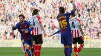 Lionel Messi menyumbangkan satu gol sekaligus membantu Barcelona menang 2-0 atas Athletic Bilbao pada laga pekan ke-29 La Liga Spanyol, di Camp Nou, Minggu (18/3/2018). (AFP/Pau Barrena)