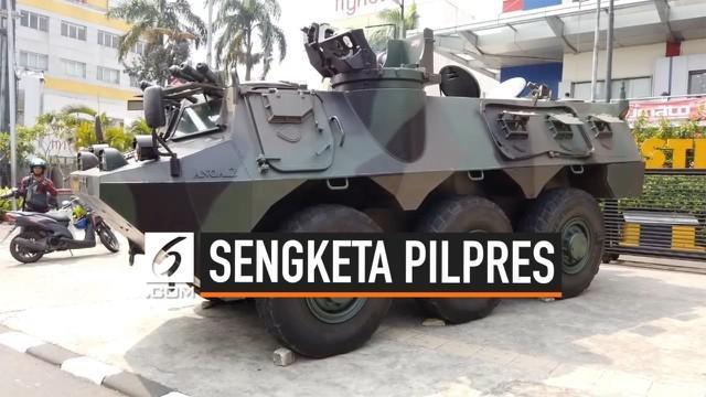 Rencana aksi massa di depangedung MK tidak menyurutkan aktivitas perdagangan di kawasan Glodok Jakarta Barat. Meski demikian 50 persenel gabungan dan 1 panser Anoa bersiaga di wilayah ini.