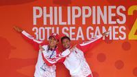 Atlet menembak Ahmad Rifqi Mukhlisin (kiri) meraih medali emas SEA Games 2019 dan Hadika Aubrey (kanan) meraih perak nomor mixed metallic silhoutte air rifle. (Perbakin)