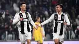 Ronaldo dan Dybala pertama dimainkan di lini depan ketika Juventus masih dinahkodai oleh Massimiliano Allegri pada musim kompetisi Serie A 2018/19. Keduanya untuk pertama kali dipasangkan hanya berdua di lini depan. (AFP/Marco Bertorello)