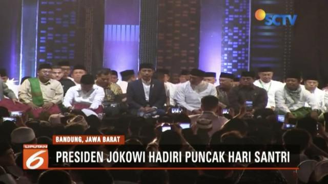 Hadiri malam puncak Hari Santri Nasional, Presiden Jokowi ingatkan umat muslim tidak terpecah belah oleh hoaks di tahun politik.
