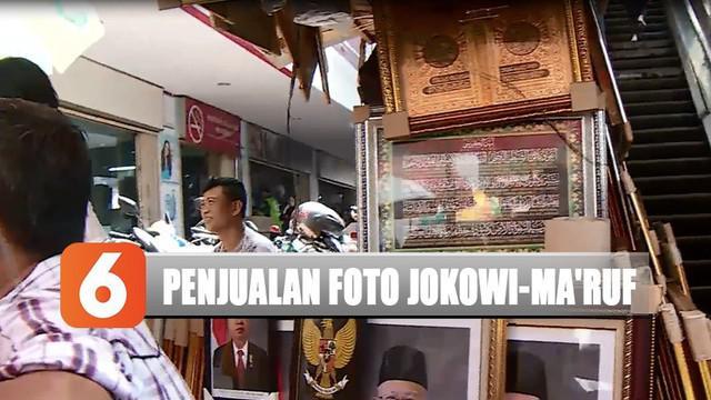 Salah satunya di Pasar Baru, Jakarta Pusat. Banyaknya pemesan jadi alasan penjual mulai menjajakan foto resmi presiden dan wakilnya.