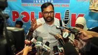 """Koordinator KontraS Haris Azhar memberi keterangan kepada wartawan seusai menjadi pembicara dalam diskusi """"Telenovela KPK-Polri"""" di Cikini, Jakarta, Sabtu (2/5/2015). (Liputan6.com/Helmi Afandi)"""