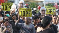 Peserta Aksi 365 menuntut kasus Novel Baswedan yang tak kunjung terungkap, seberang Istana Negara, Jakarta, Rabu (11/4). Hari ini tepat 1 tahun sejak penyidik senior KPK Novel Baswedan diserang menggunakan air keras. (Liputan6.com/Immanuel Antonius)