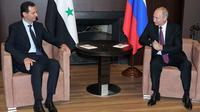 Presiden Rusia Vladimir Putin dan Presiden Suriah Bashar al-Assad bertemu di Sochi  (Mikhail Klimentyev, Sputnik, Kremlin Pool Photo via AP)