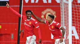 Anthony Elanga. Sayap Manchester United berusia 19 tahun ini berhasil membuat 2 gol dalam laga pra-musim lalu. Kecerdikan mencari posisi merupakan kelebihannya yang dapat dimaksimalkan pelatih Ole Gunnar Solskjaer pada musim ini.(Foto: AFP/Paul Ellis)