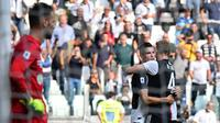 Cristiano Ronaldo menyumbangkan satu gol sekaligus membantu Juventus menang 2-0 atas SPAL, pada laga pekan keenam Serie A di Allianz Stadium, Sabtu (28/9/2019). (AFP/Andreas Solaro)