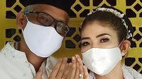 Fira Basuki resmi mengikat janji suci pernikahan dengan Nico Hermanu di tengah pandemi pada Sabtu, 18 April 2020. (dok. Instagram @firabasuki/https://www.instagram.com/p/B_HpJxBl3eK/Putu Elmira)
