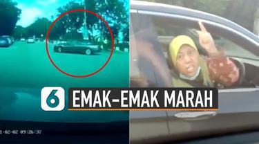 Ketegangan berlanjut, ibu-ibu pengendara sedan hitam meneriaki di lampu merah.