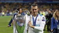Manchester United (MU) kembali berpikir soal wacana merekrut Gareth Bale dari Real Madrid. (AP Photo/Pavel Golovkin)