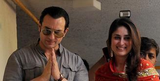 Kareena Kapoor dan Saif Ali Khan tengah menunggu kelahiran anak pertama, namun keduanya ramai menjadi sorotan dengan pakaian pengantin. Bukan menikah, namun keduanya tengah sesi foto sebuah majalah. (AFP/Bintang.com)
