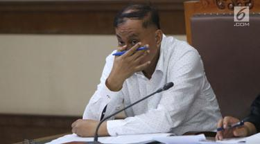 Terdakwa dugaan korupsi e-KTP, Markus Nari menyimak keterangan saksi saat mengikuti sidang lanjutan di Pengadilan Tipikor, Jakarta, Rabu (11/9/2019). Sidang beragendakan mendengar keterangan saksi-saksi. (Liputan6.com/Helmi Fithriansyah)