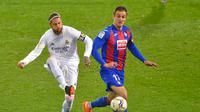 Kapten Real Madrid, Sergio Ramos saat melawan Eibar pada laga lanjutan Liga Spanyol 2020/2021, Senin (21/12/2020) dini hari WIB. (ANDER GILLENEA / AFP)