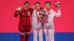 Leani Ratri Oktila kembali naik podium dengan mendapatkan medali perak pada laga final tunggal putri SL4 cabang olahraga bulutangkis Paralimpiade Tokyo 2020 di Yoyogi National Stadium, Minggu (5/9/2021) pagi WIB. (Foto: AFP/OIS/IOC/Joe Toth)