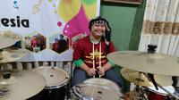 Imansyah Aditya Fitri pemain drum down syndrome. Foto: Emsyarfi.