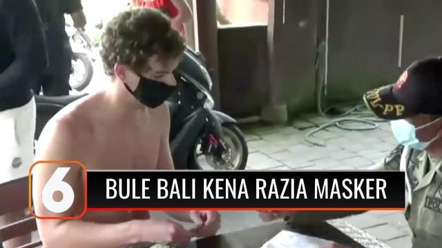 Petugas gabungan menjaring puluhan warga negara asing (WNA) di kawasan Kuta Utara, Bali, yang tidak memakai masker. Petugas menjatuhkan denda Rp 100 ribu kepada para turis asing yang tidak memakai masker.