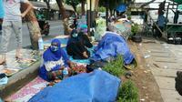 Pengungsi Somalia menelantar di trotoar jalan di depan Rumah Detensi Imigrasi, Kalideres, Jakarta Barat (4/4/2018) (Rizki Akbar Hasan/Liputan6.com)