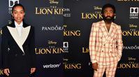 Yara Shahidi dan Donald Glover memakai suit Gucci Fall Winter 2019-2020 di premiere The Lion King (Dok. Gucci)