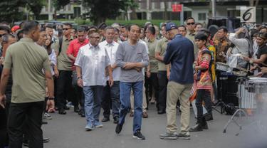 Presiden Joko Widodo tiba di Stasiun MRT Istora Mandiri, Jakarta, Minggu (24/3). Jokowi dijadwalkan bakal meresmikan beroperasinya moda raya terpadu (MRT) Jakarta fase I Lebak Bulus-Bundaran HI hari ini, Minggu, 24 Maret 2019. (Liputan6.com/Faizal Fanani)