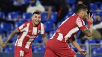 Striker Atletico Madrid Uruguay Luis Suarez merayakan gol keduanya ke gawang Getafe dalam laga La Liga Spanyol di Stadion Coliseum Alfonso Perez, Rabu (21/9/2021) dini hari WIB. (JAVIER SORIANO / AFP)