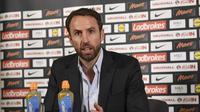 Pelatih tim nasional Inggris, Gareth Southgate dalam sebuah jumpa pers. (AFP/Paul Ellis)