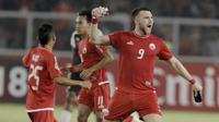 Striker Persija Jakarta, Marko Simic, melakukan selebrasi usai mencetak gol ke gawang Home United pada laga Piala AFC di SUGBK, Jakarta, Selasa (15/5/2018). Persija takluk 1-3 dari Home United. (Bola.com/M Iqbal Ichsan)