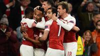 Pemain Arsenal merayakan gol ke gawang Valencia dalam leg pertama semifinal Liga Europa 2018-2019 di Emirates Stadium, Jumat (3/5/2019) dini hari WIB. (AFP/Glyn Kirk)