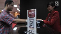 Suasana pelayanan samsat digital (e-Samsat) di Polda Metro Jaya, Jakarta, Senin (26/3). Pembayaran dapat dilakukan secara nontunai via JakOne Mobile dan kartu debit Bank DKI serta bank lain yang mendukung layanan e-Samsat. (Merdeka.com/Iqbal S. Nugroho)