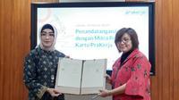 Ki-ka: Direktur Layanan dan Jaringan BNI Adi Sulistyowati, Direktur Eksekutif Manajemen Pelaksana Denni Puspa Purbasari melakukan MoU terkait Program Kartu Pra Kerja di Jakarta, Jumat (20/3).