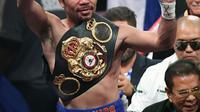 Petinju Manny Pacquiao merebut sabuk juara WBA (Super) welterweight dari Keith Thurman dalam pertarungan tinju di MGM Garden Arena, Las Vegas, Sabtu (20/7/2019). Setelah melalui duel 12 ronde, Pacquiao selaku penantang gelar berhasil keluar sebagai pemenang (Ethan Miller/GETTY IMAGES/AFP)