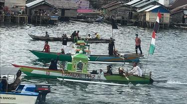 Konvoi perahu warga Pagimana saat menyambut hari raya Idulfitri (Arfandi/Liputan6.com)