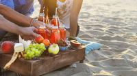 Ilustrasi piknik di pantai (iStockphoto)