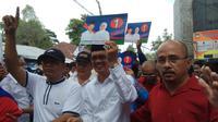 Harnojoyo-Fitrianti Agustinda menjadi paslon yang mendapat nomor urut pertama di Pilkada Palembang (Liputan6.com / Nefri Inge)