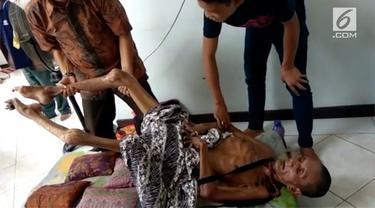 Sejak mengalami kecelakaan 24 tahun lalu, Maz Tazul Munir menderita rematik akut sehingga membuat tubuhnya kaku seperti kayu.