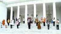 Perwakilan yang mendapat Vaksin Covid-19 di Istana Negara. Liputan6.com